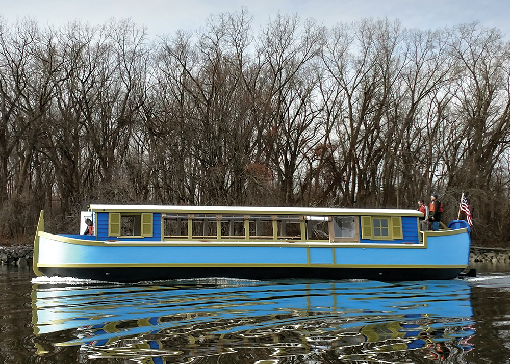 Scarano-built 54-foot 19th century-style canal boat historic replica out on water with passengers